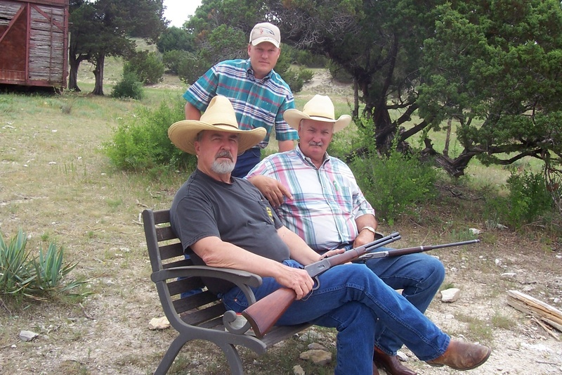 My son Chancey standing and my friend Sonny King and I on the bench. We were doing a little target shooting for fun on my ranch.